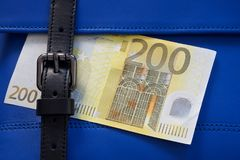 Blue leather bag stitching with black buckle and money royalty free stock images
