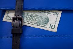 Blue leather bag stitching with black buckle and money stock photos