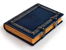 Blue leather book with silvered frame, aged pages and metal clasps. stock photos