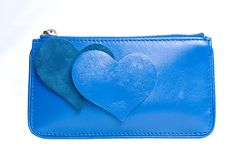 Blue leather purse with hearts isolated on white Royalty Free Stock Photos