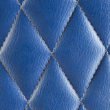 Blue leather seat background. Royalty Free Stock Image
