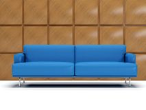 Blue leather sofa and boiserie. Blue sofa with decorated wall with square panels of wood Stock Image