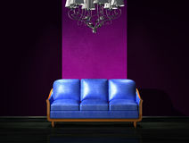 Blue leather sofa with luxury chandelier Royalty Free Stock Photography