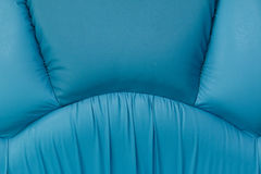 Blue leather sofa with stitch texture Stock Images