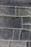 Blue leather, white stitches Stock Photos