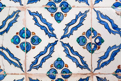 Blue leaves and berries in a pattern tiles Royalty Free Stock Image