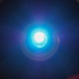 Blue led light. Bright blue led light over dark background Stock Image