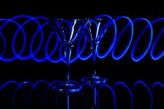 Blue led light trails on  martini glasses Stock Image