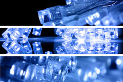 Blue led lights in three strips. Blue led lights in three landscape strips with black background stock photos