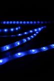 Blue leds. Led blue stripes black background stock photography