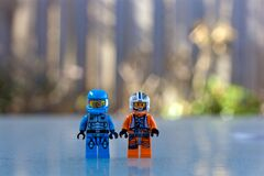 Blue Lego Toy Beside Orange and White Lego Toy Standing during Daytime Royalty Free Stock Photography