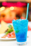 Blue lemon italian soda on white table Royalty Free Stock Photos