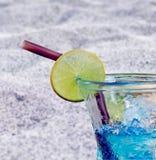 Blue lemon soda with black sand beach wallpaper Royalty Free Stock Photo