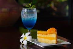 Blue lemon soda and Orange Cake. Blue lemon soda in glass and Orange Cake Stock Image