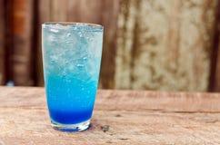 Blue lemon soda on wood table Stock Photo