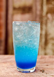 Blue lemon soda on wood table Royalty Free Stock Photo