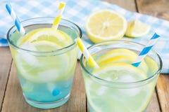 Blue lemonade with fresh lemons Stock Images
