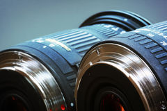 Blue Lenses. 2 lenses of a camera placed next to each other royalty free stock images
