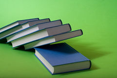 Blue library. Blue books stacked up on a green background Stock Images