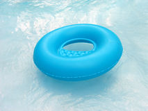 Blue lifebuoy in pool. Blue lifebuoy floating in a pool Royalty Free Stock Image