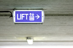 Blue lift elevator sign. On the ceiling during daytime Royalty Free Stock Photos