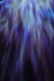 Blue Light. A background or abstract image of blue light against a dark surface Royalty Free Stock Photo