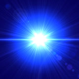 Blue light. Abstract lens flare light over blue background Stock Images