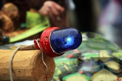 Blue light as a decoration on vehicles. Of a carnival parade Stock Photo