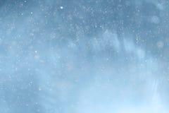 Blue light background abstract. Bokeh light snow Stock Photos