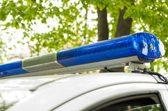 Blue light bar on the police car Royalty Free Stock Image