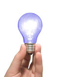 Blue light bulb in hand Royalty Free Stock Images