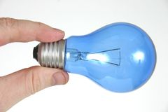 Blue light bulb in hand 3 Stock Image
