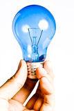 Blue light bulb in hand, Isolated Stock Photos