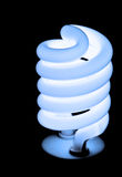 Blue Light Bulb. Isolated blue light bulb with black background royalty free stock photo