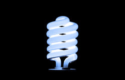 Blue Light Bulb. Isolated blue light bulb with black background royalty free stock photos
