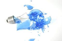 Blue light bulb smashed 2. Blue light bulb on white Royalty Free Stock Image