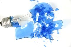 Blue light bulb smashed 3. Blue light bulb on white Royalty Free Stock Photos