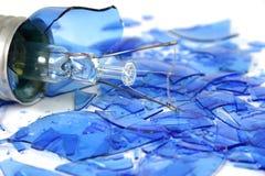 Blue light bulb smashed 6. Blue light bulb on white Stock Photo