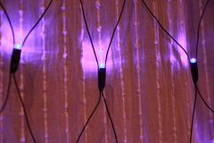 Blue Light Bulbs In Illumination On A Translucent Curtain For royalty free stock photography