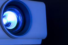 Blue light data projector. Close up of data projector Royalty Free Stock Photo