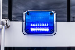 Blue light. Flashing blue light from a police truck Royalty Free Stock Photo