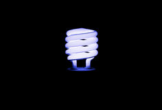 Blue light florescent bulb in the dark Royalty Free Stock Image