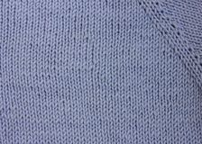 Blue light knitted wool background Stock Images