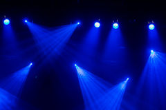 Blue light. Lighting equipment, spotlights on the stage during the show or performance.  Stock Images