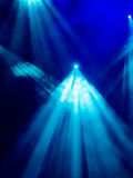 Blue light rays from the spotlight through the smoke at the theater or concert hall. Lighting equipment Stock Images