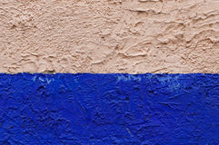 A blue and light salmon color wall texture. Good for backgrounds and commercial work royalty free stock photo