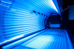 Blue light solarium. Tanning bed solarium with blue light  accelerating skin aging Royalty Free Stock Photos