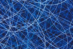 Light striped trails with chaotic movements. Blue light striped trails with chaotic movements Stock Image