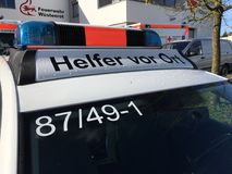 German Red Cross. Blue light on the top of an ambulance Stock Photos