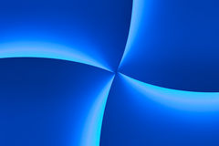 Blue Light Wave Background. Blue gradients of light in quarter sectors intersecting in center. This is not CG, but a real photo of an illuminated surface stock images
